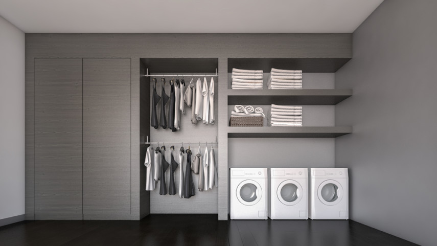 Multiple machines in laundry room plus hanging bar for clothes