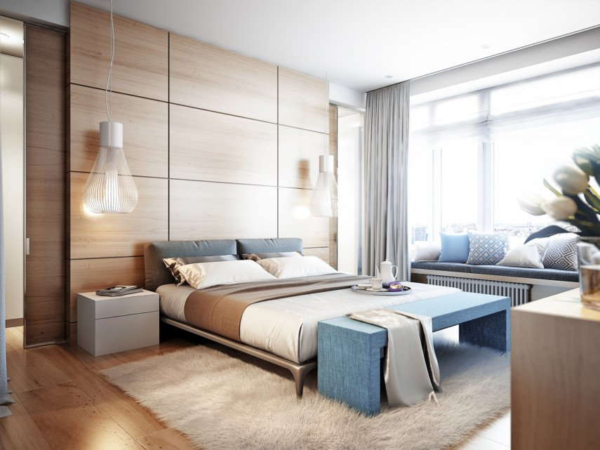 Floor to ceiling wooden bedroom with a large windowsill filled with cushions