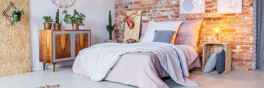 Modern bedroom decor with brick wall and warm lighting