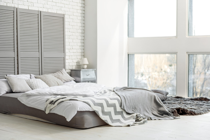 Gray and white bedroom with large floor to ceiling windows