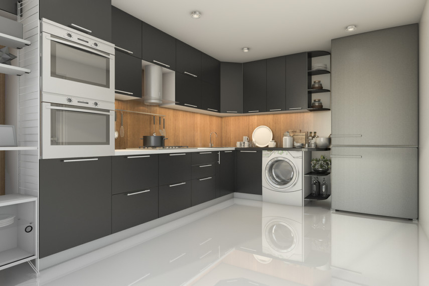 Kitchen laundry room contrasts dark cabinets with light colored paneling and appliances