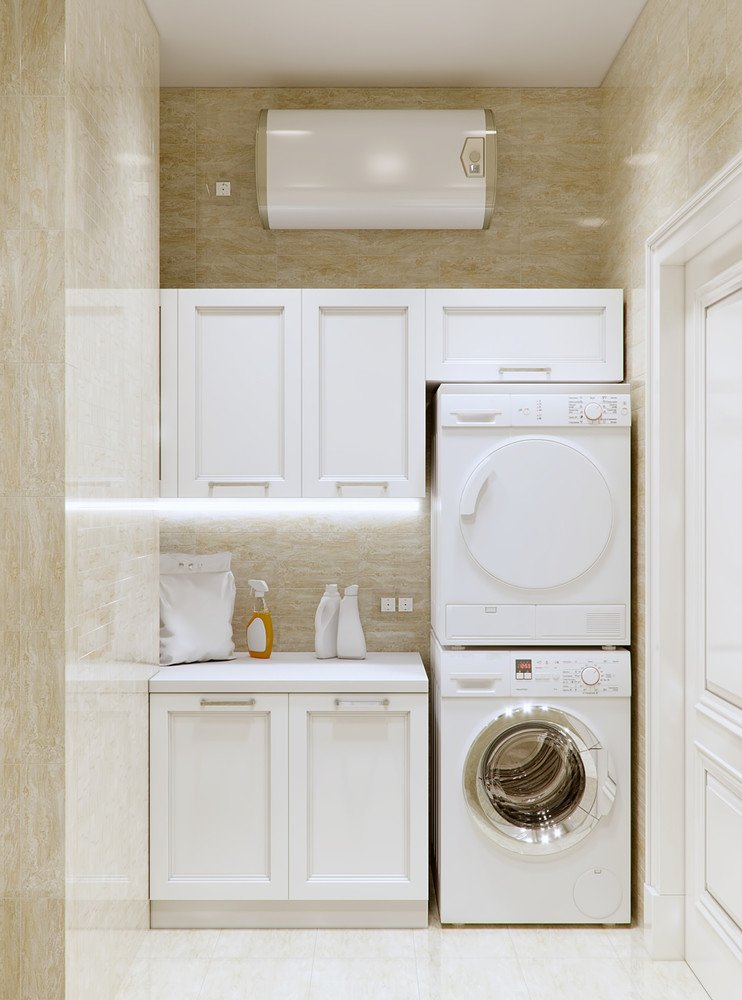Cabinets, countertop, stacked appliances make this small space laundry room oranized