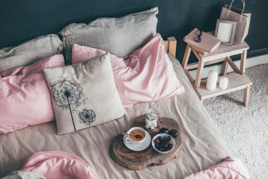 Aerial view of a breakfast tray on a bed