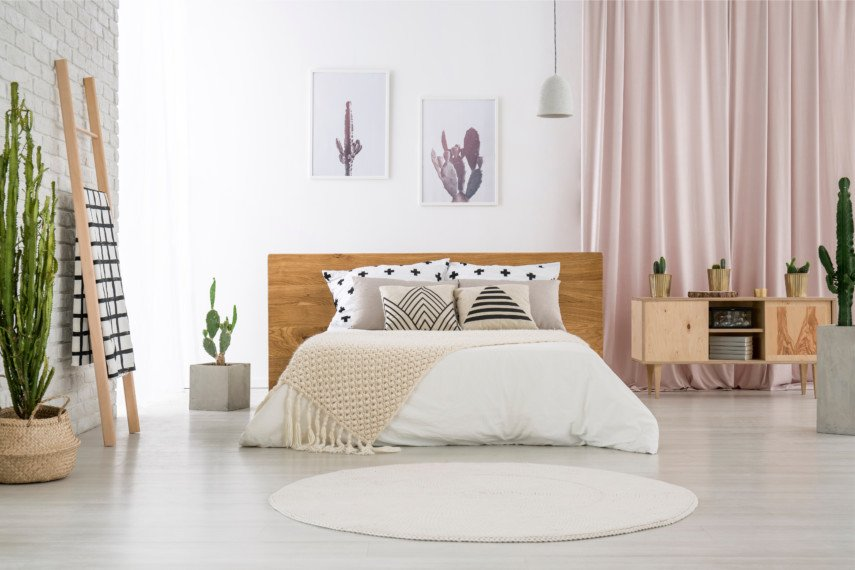 White and pastel bedroom with geometric accents and cacti