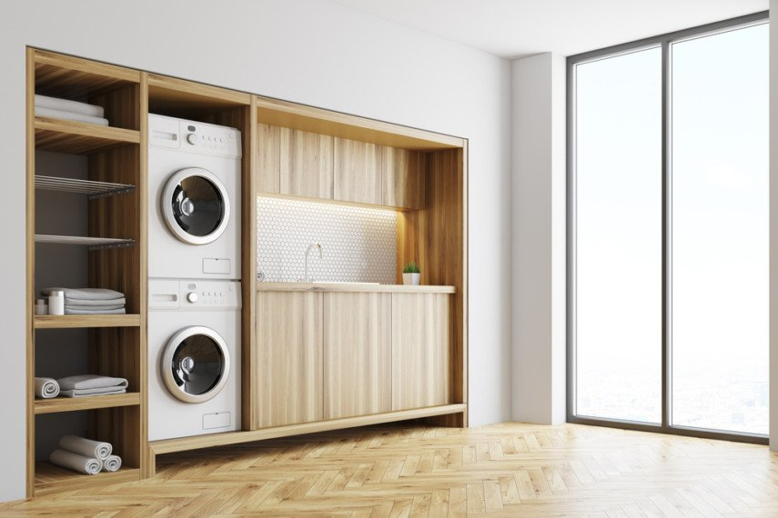 Modern style laundry room with stacked washer and dryer