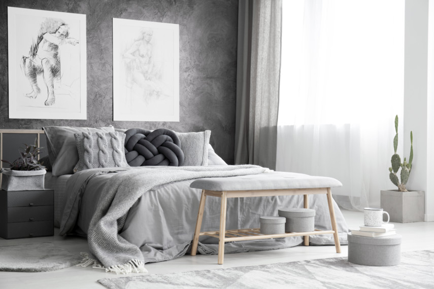 Monochromatic gray bedroom with unique throw pillows