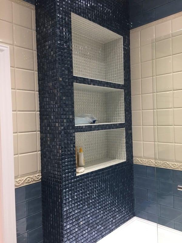 dark mosaic shower niche